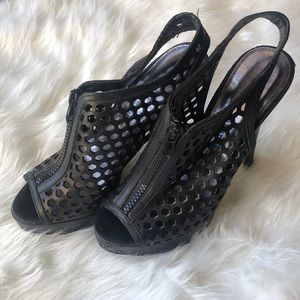 Black, leather perforated, zipper, heels.